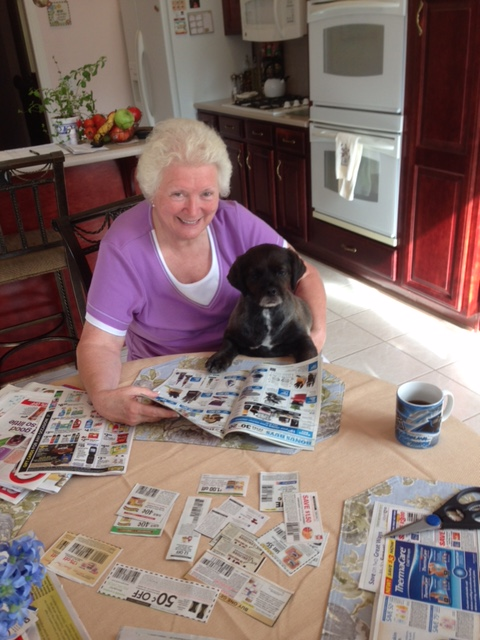 Kay and LD reading the paper. While we were building our house and driving down I-85 about 4 times a week, we thought to teach our dog to drive. His name is LD. Lost Dog. He found us in May 2009. And is the best pet ever